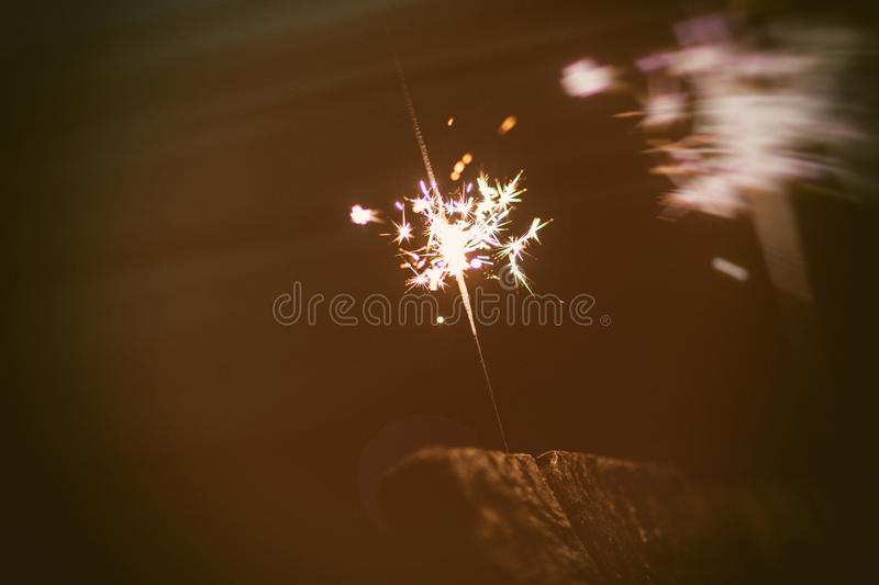 Sparks in the dark. Sparks. Christmas and New Year time. Magic light. Fire, black, flame, hot, abstract, energy, heat, bright, yellow, night, danger, burn stock photos