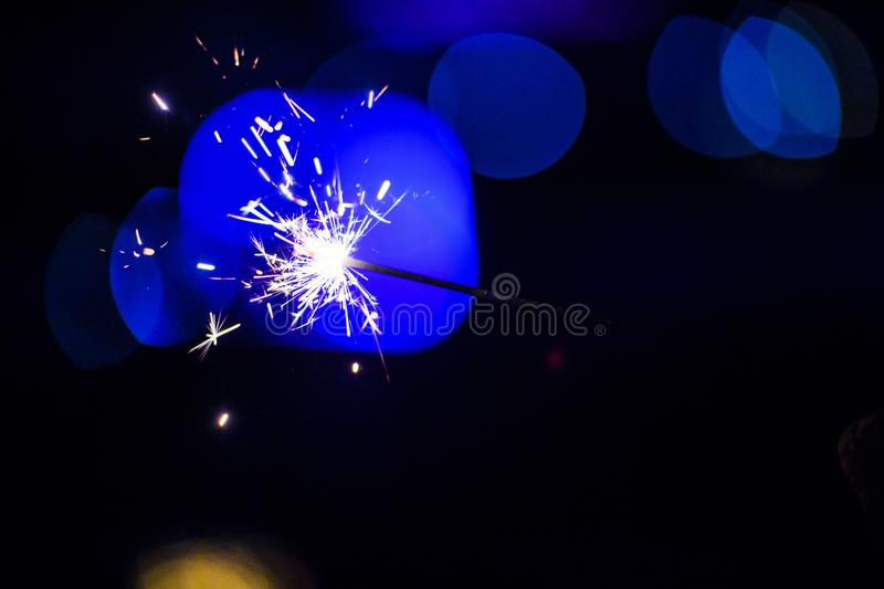 Sparks in the dark. Sparks. Christmas and New Year time. Magic light. Fire, black, flame, hot, abstract, energy, heat, bright, yellow, night, danger, burn stock images
