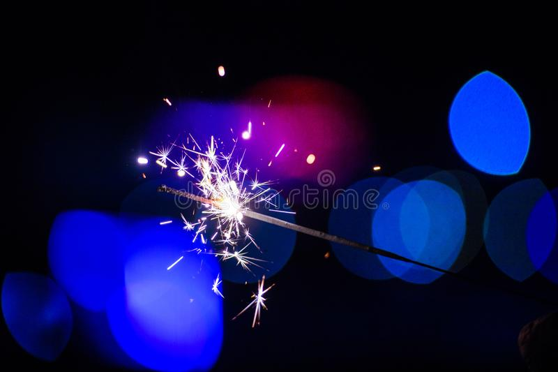 Sparks in the dark. Sparks. Christmas and New Year time. Magic light. Fire, black, flame, hot, abstract, energy, heat, bright, yellow, night, danger, burn royalty free stock photo