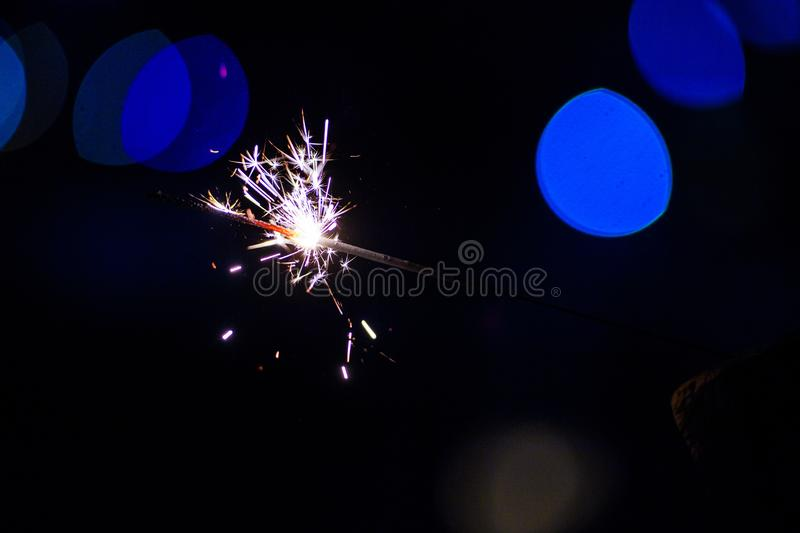 Sparks in the dark. Sparks. Christmas and New Year time. Magic light. Fire, black, flame, hot, abstract, energy, heat, bright, yellow, night, danger, burn royalty free stock image