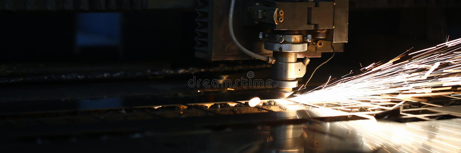 Sparks fly out machine head for metal processing royalty free stock photo