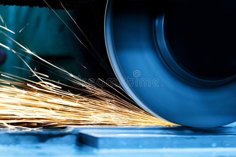 Sparks from grinding machine. Industrial, industry. Sparks from grinding machine in workshop. Industrial background, industry royalty free stock image