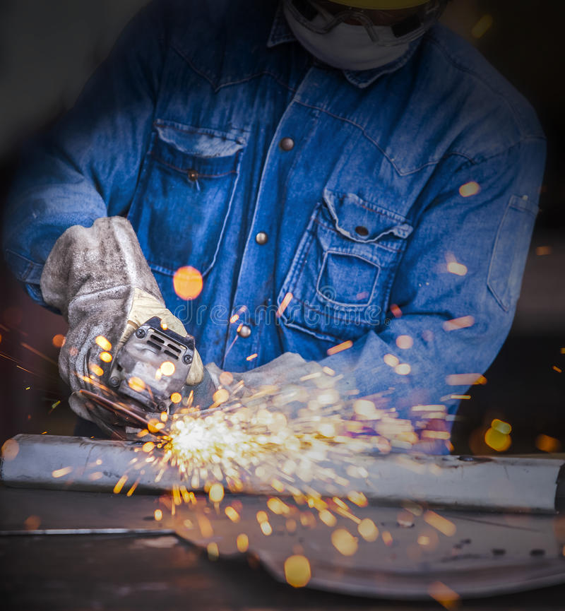 Sparks while grinding royalty free stock photography