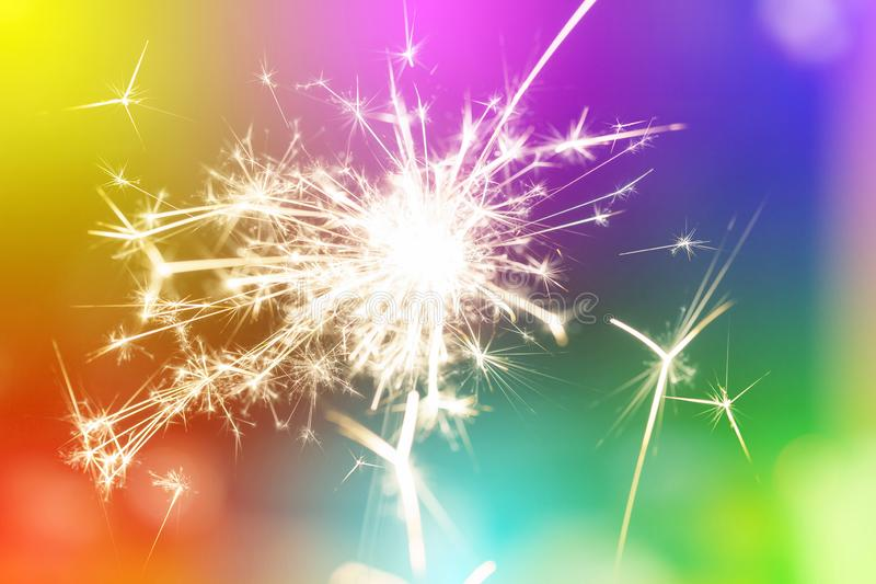 Sparks from hand cold fireworks colorful background royalty free stock images