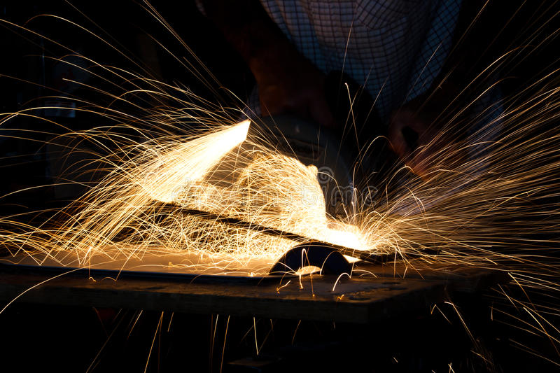 Sparks from metalwork. Slow shutter speed photo of sparks resulting from metalwork royalty free stock photography