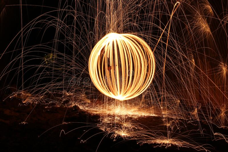 Sparks and orb of light painting stock photography