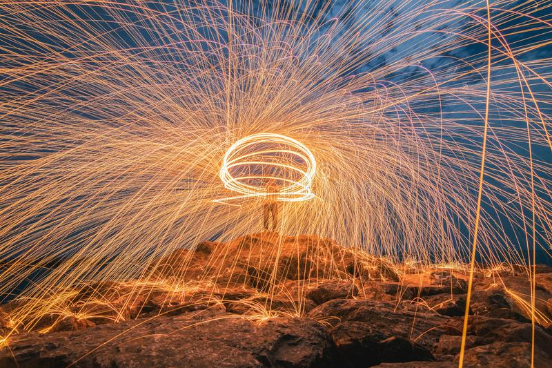 Sparks from steel. Steel wool stock photo