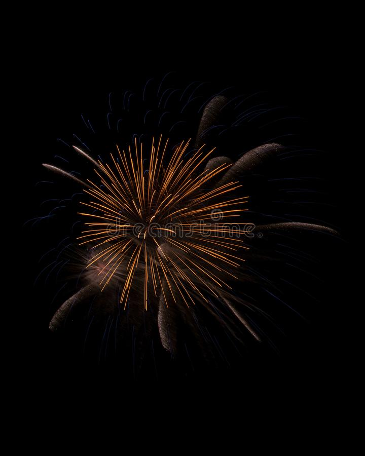 Sparks and trails of firework explosion isolated on black royalty free stock photos