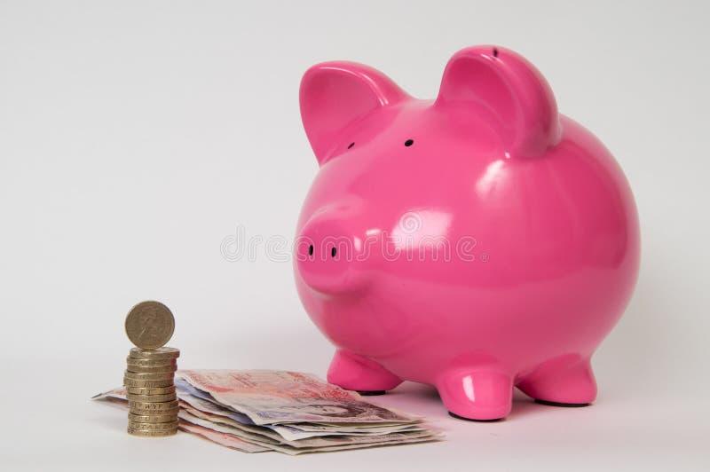 Sparschwein mit GBP stockfotos