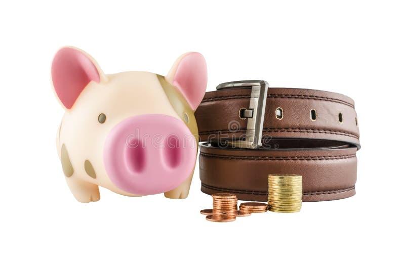 Sparschwein und Münzen, lokalisiert auf weißem Hintergrund stockfotos