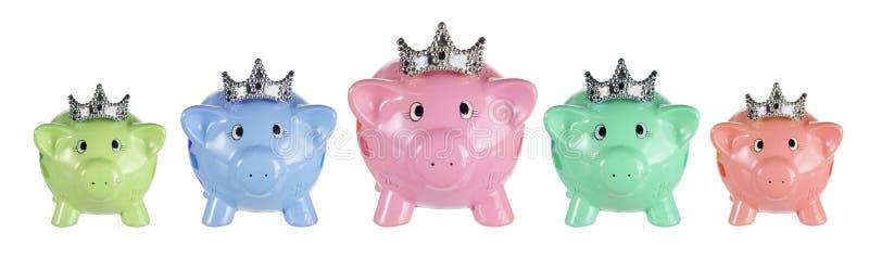 Sparschweine mit Kronen lizenzfreie stockfotografie