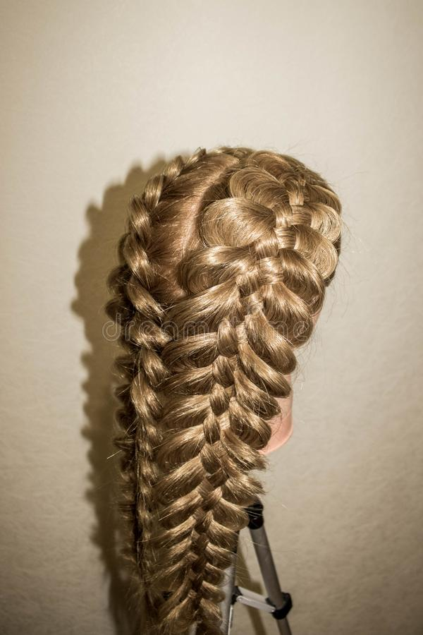 Spatial braids of 5 strands. On the training mannequin with hair stock images