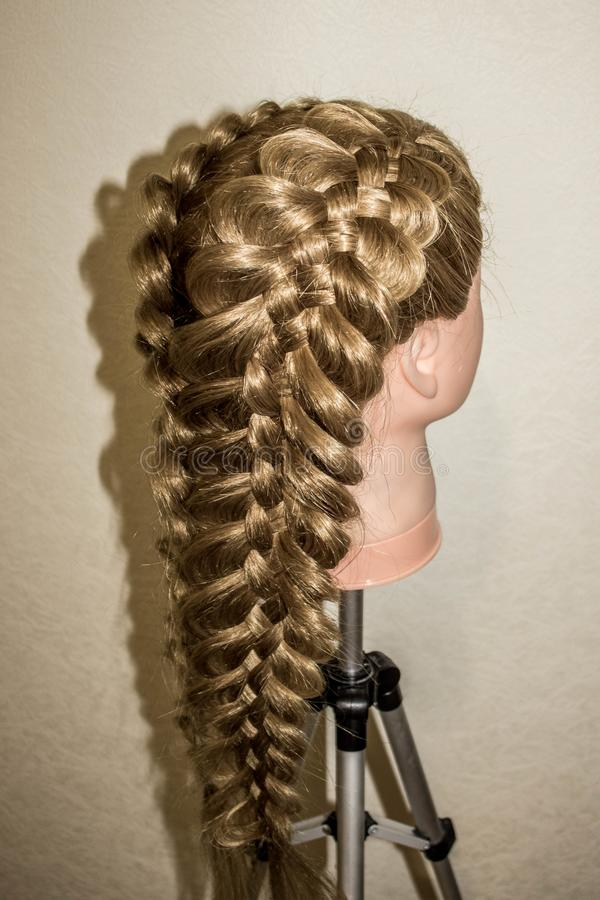 Spatial braids of 5 strands. On the training mannequin with hair royalty free stock photos