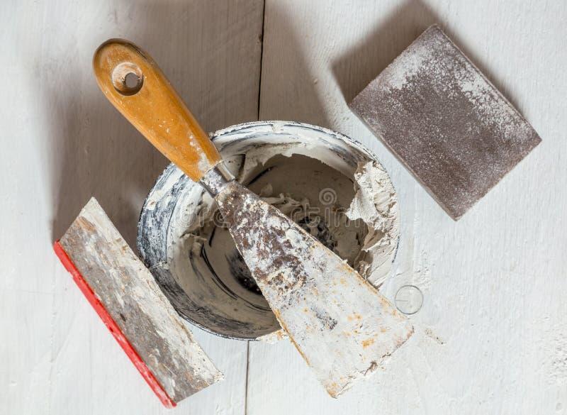 Spatula mixing tub and sanding block.  stock image