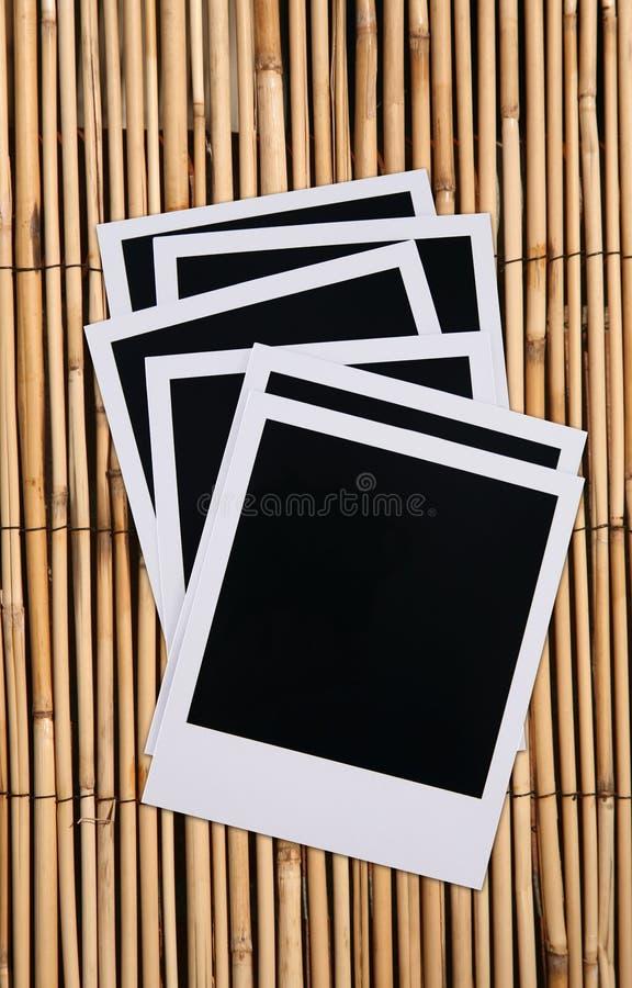 Spazii in bianco della pellicola del Polaroid fotografia stock