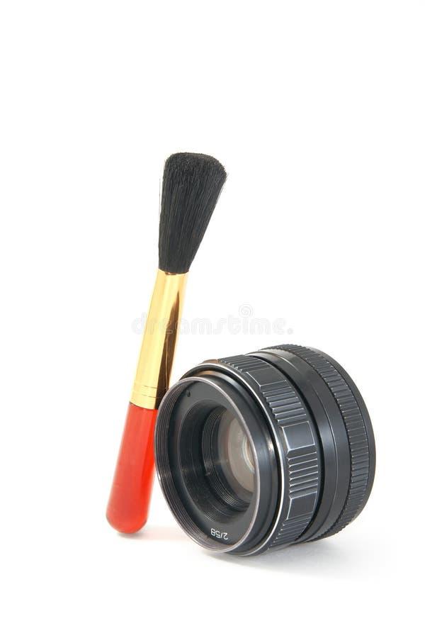 Spazzola con l'obiettivo fotografia stock libera da diritti
