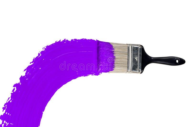 Spazzola con vernice viola fotografie stock