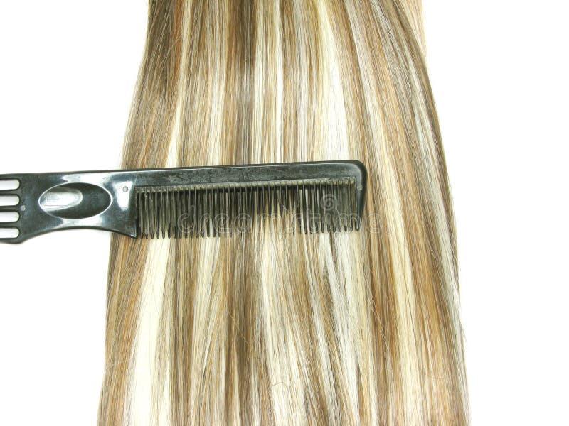 Spazzola di capelli con i capelli di punto culminante in esso immagine stock