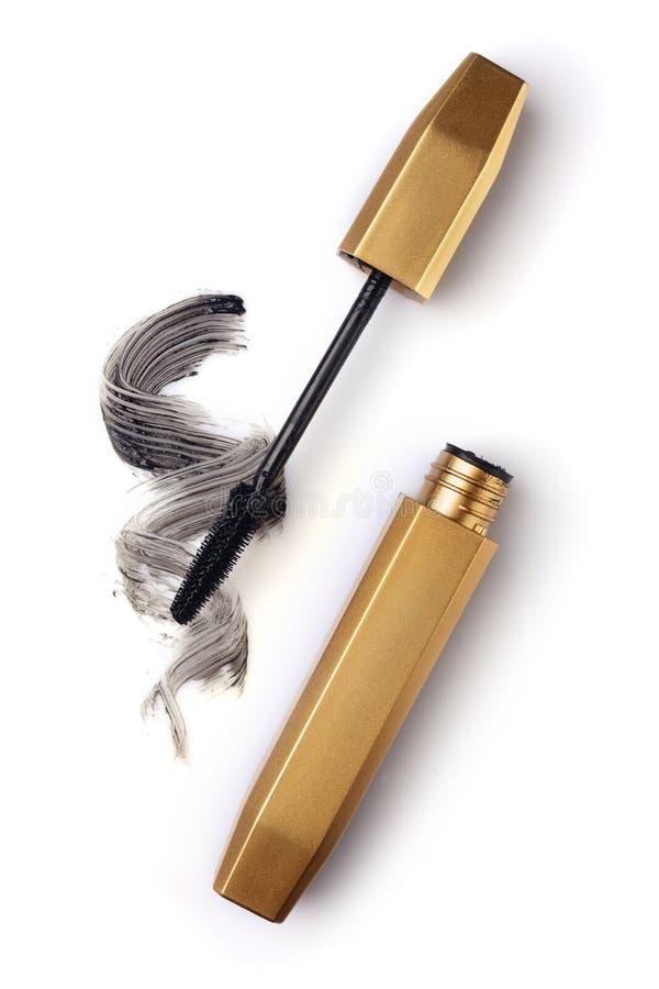 Spazzola dorata dei colpi della pittura e della mascara fotografie stock libere da diritti