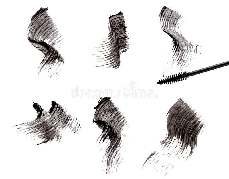 Spazzola e colpi della mascara fotografie stock libere da diritti