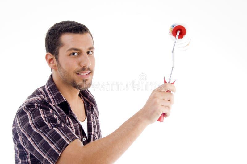 Spazzola maschio del rullo della holding fotografie stock libere da diritti