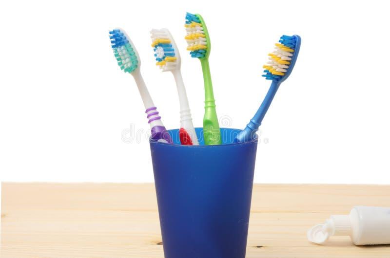 Spazzolino da denti dello spazzolino da denti in vetro su bianco immagini stock libere da diritti