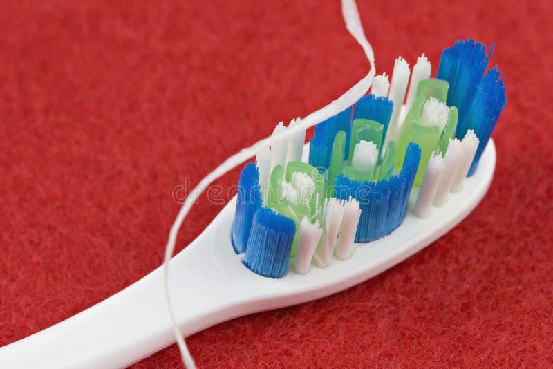 Spazzolino da denti e filo di seta fotografia stock