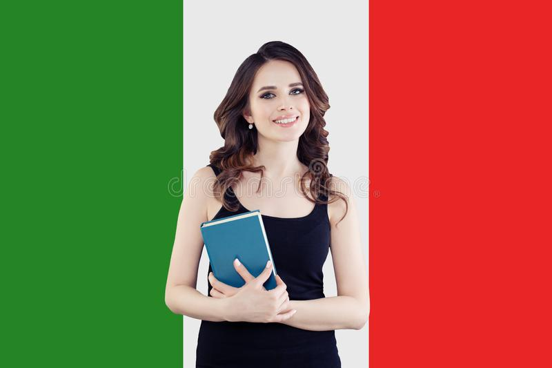 Speak italian language concept. Happy woman on the Italy flag background. Travel and learn italian language royalty free stock photo