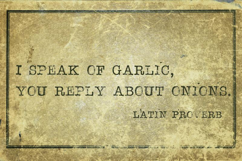 Speak of LP. I speak of garlic, you reply about onions - ancient Latin proverb printed on grunge vintage cardboard royalty free illustration