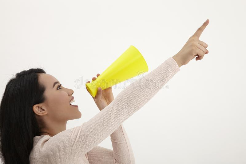 Speak out. Malay woman using megaphone on the white background royalty free stock photos