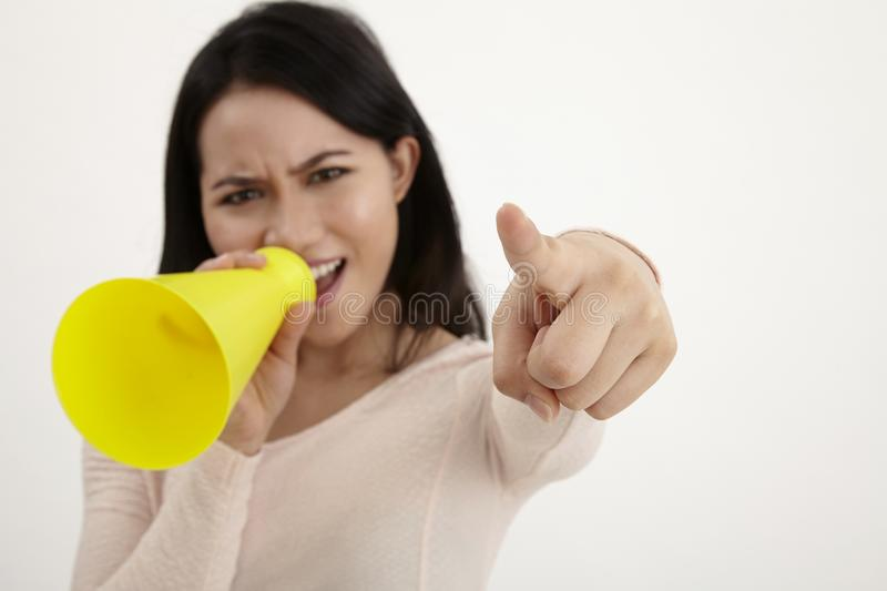 Speak out. Malay woman using megaphone on the white background stock images