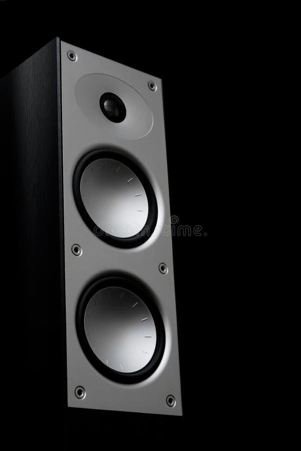 Speaker 1. Silwer audio speaker on a black background stock photos