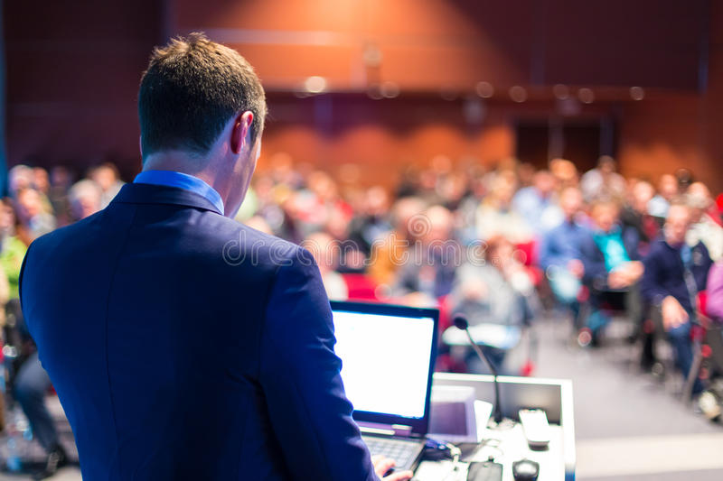 Speaker at Business Conference and Presentation. Audience at the conference hall stock photos