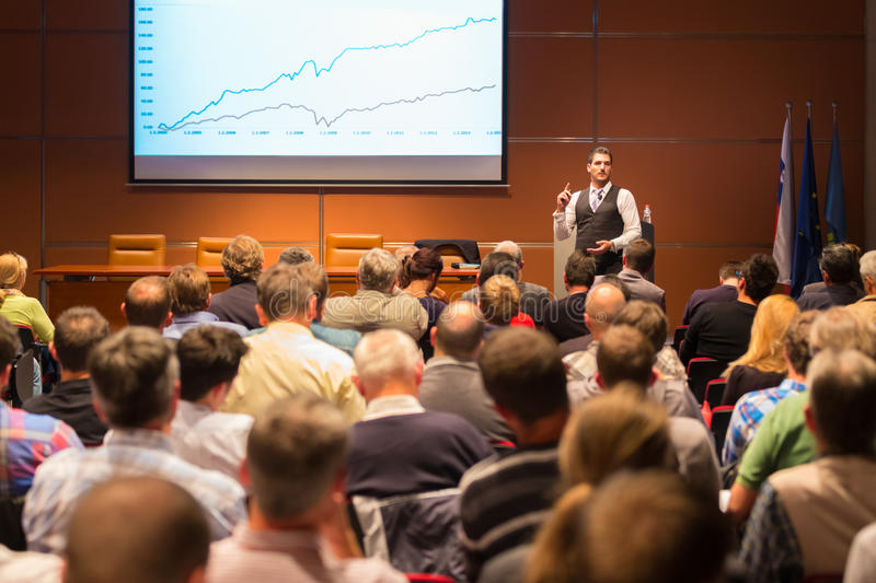 Speaker at Business Conference and Presentation. Audience at the conference hall. Business and Entrepreneurship royalty free stock image