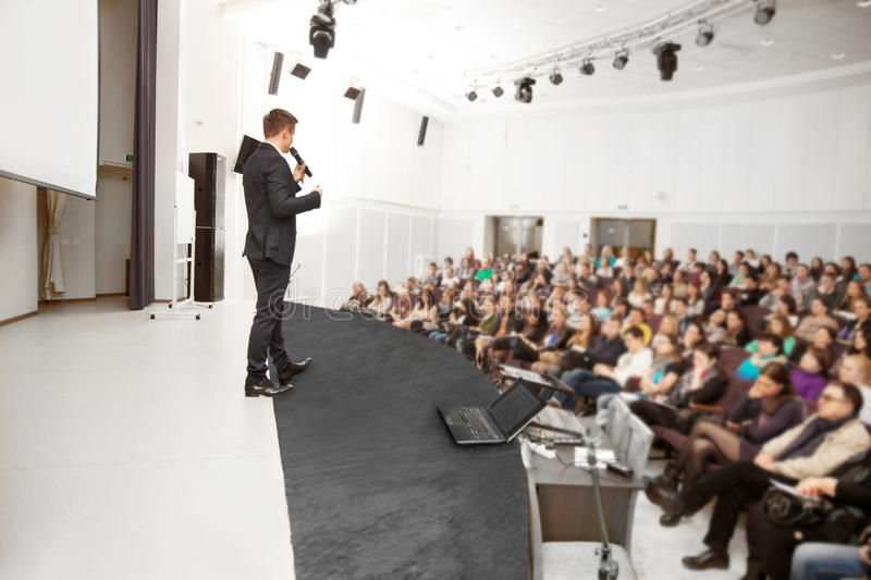 Speaker at Business convention stock images