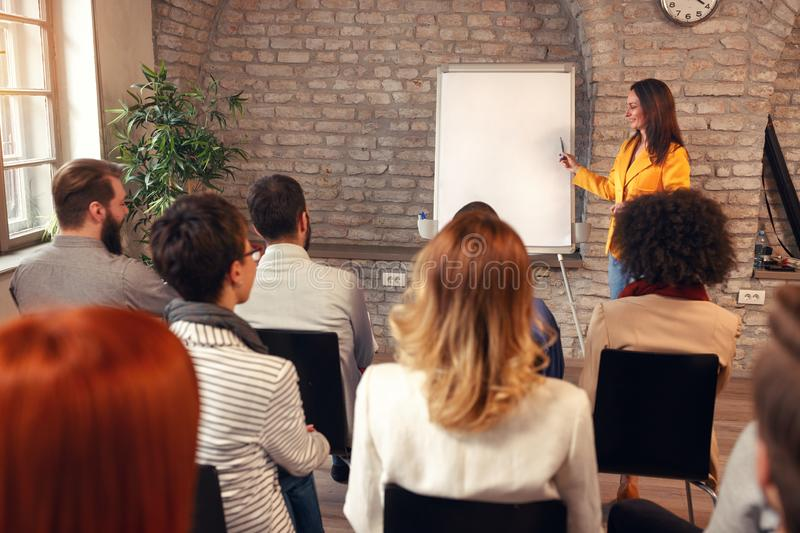 Speaker at business convention and presentation stock image