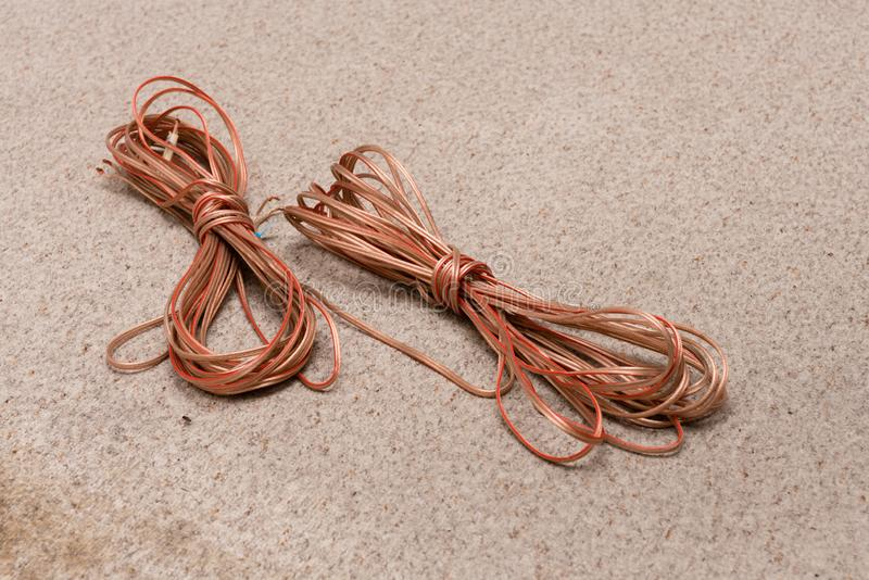 Speaker cable on the floor. Speaker cable lying on a carpet royalty free stock photography