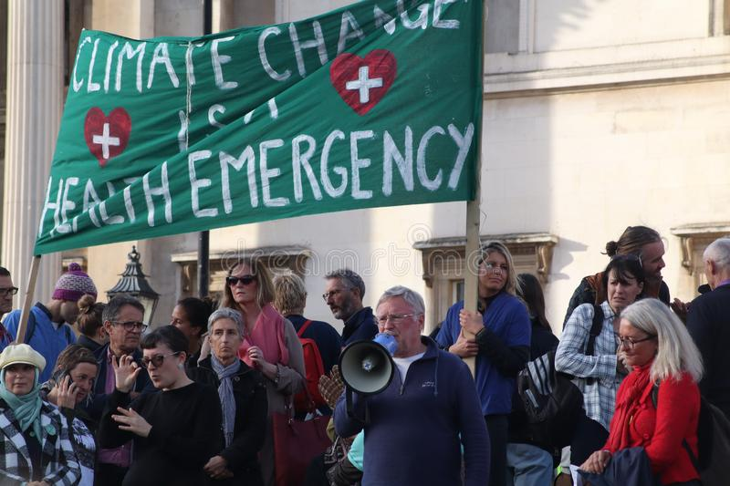 Speaker at Extinction Rebellion Protest With Banner. royalty free stock image