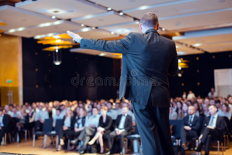 Speaker giving talk at business conference event stock photo