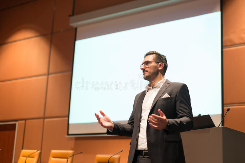 Speaker giving talk at Business Conference. stock image