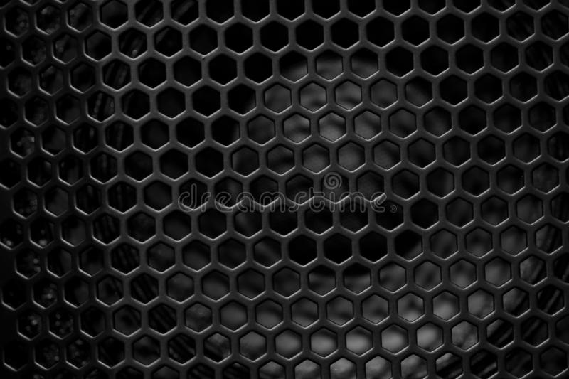 Speaker for sound and music. Loudspeaker speaker behind the bars with a rhythmic pattern royalty free stock photo