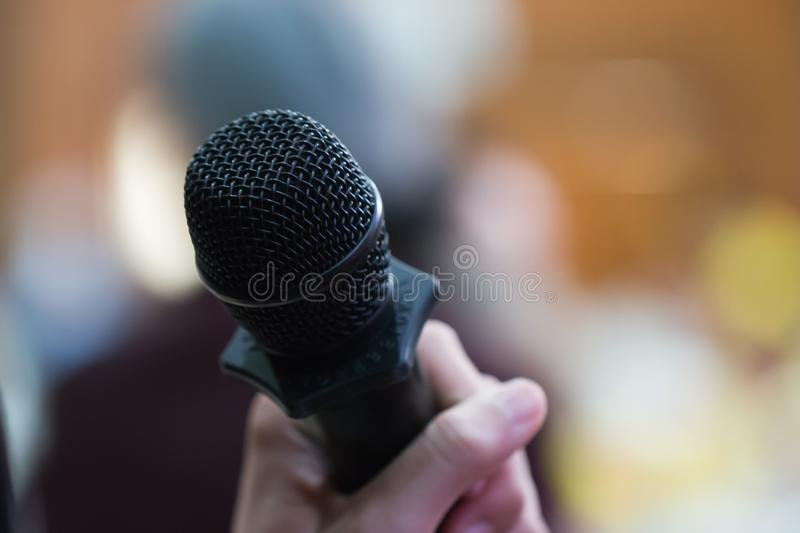 Speaker speaking on Microphone in Conference room or seminar meeting hall in business event or academic classroom training in royalty free stock photos