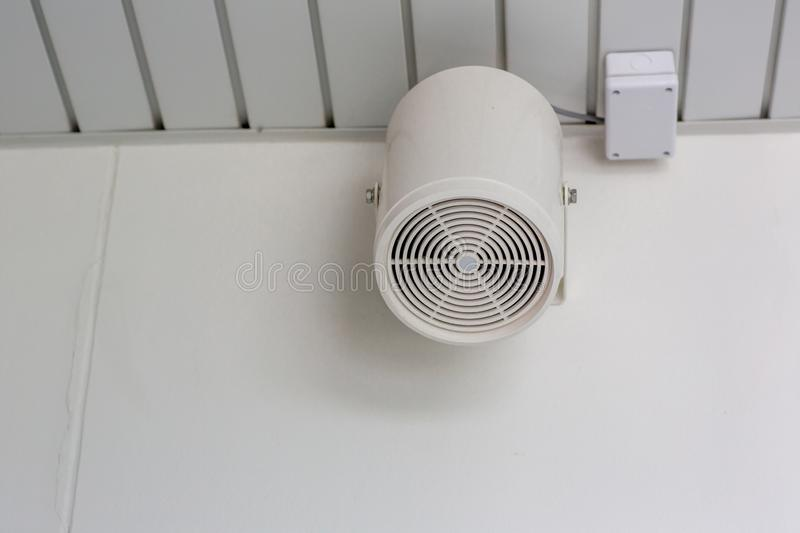 Speakers on a wall of building .Loud speaker in factory. Pair of loudspeaker on the wall of car park building,broadcasting technol stock photography