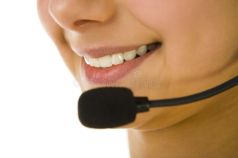 Speaking. Half woman's face with microphone. Focused on mouth. White background