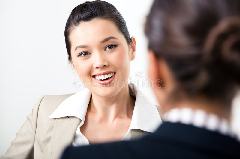 Speaking. Portrait of confident business lady looking at partner and speaking to her
