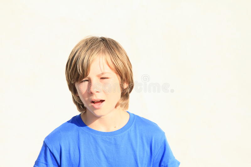Speaking boy. Face of a speaking little boy in blue t-shirt stock images