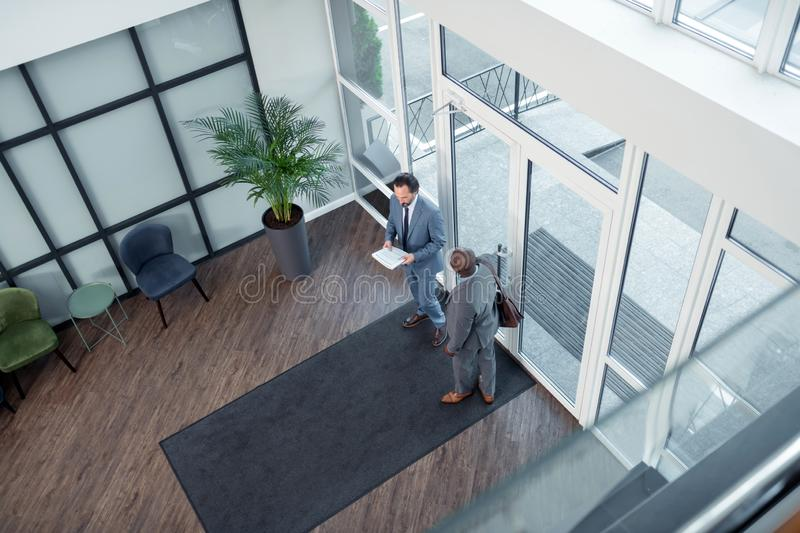 Colleague speaking with businessmen and going to the meeting stock photos
