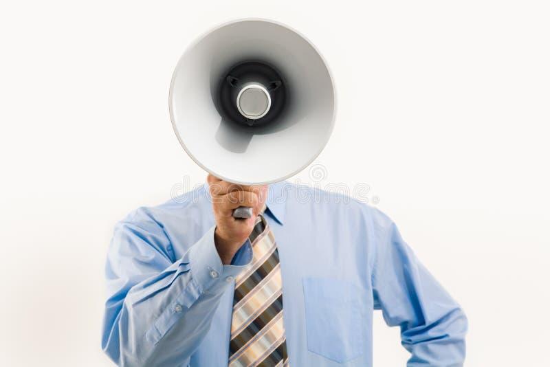 Speaking through megaphone royalty free stock photo