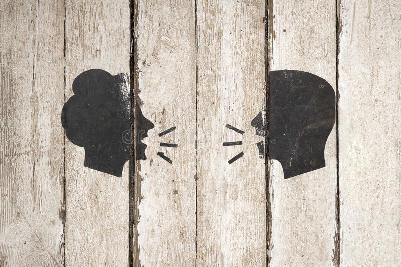 Speaking people silhouette on wooden background. Man and woman conversation icon illustration isolated on white royalty free stock image