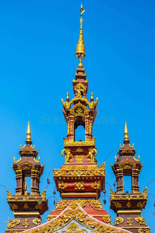 Top of the gate in temple Chiangrai Thailand. Spear shape cement architecture on the roof of the gate in temple Chiangrai Thailand royalty free stock image